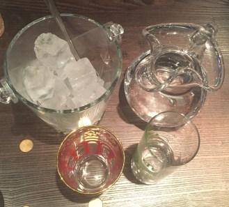 Ice cubes, Water, Empty glass and Efe Green Raki