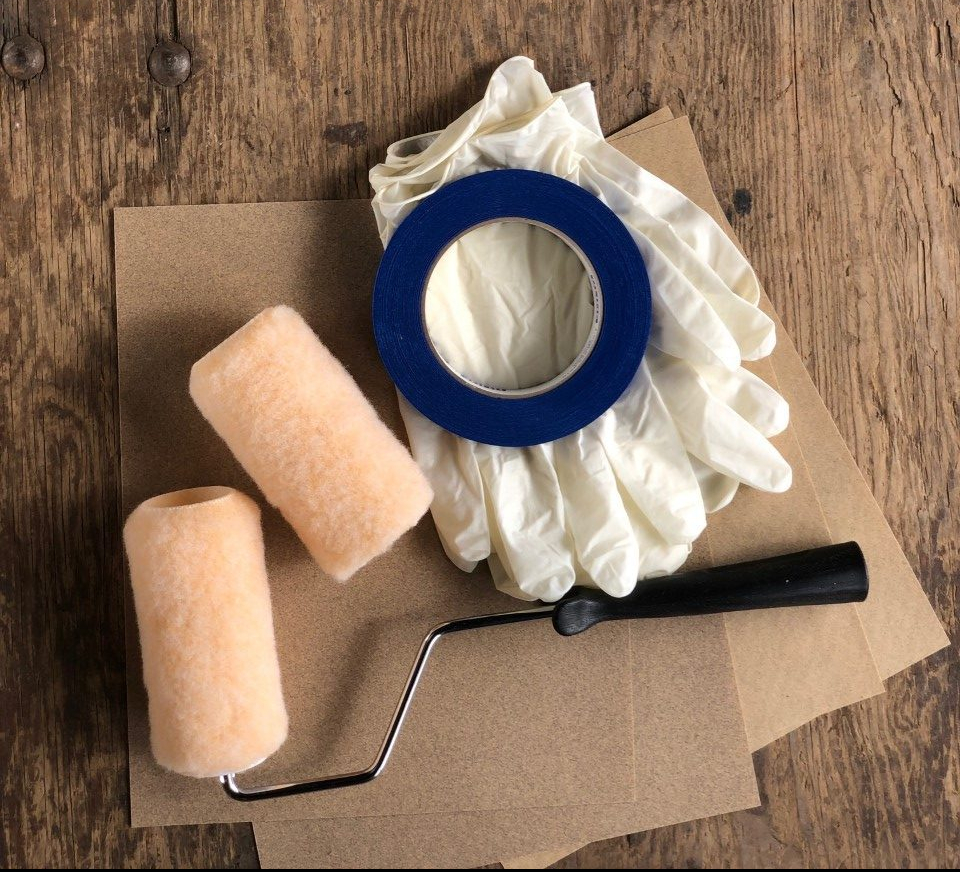 Picture of Wetlander application kit containing two roller covers, one roller handle, 4 plastic gloves and one roll of painters tape
