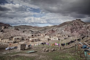 Although reinforced concrete houses became widespread in villages, adobe houses still exist. Hosap, Van, April 2011.