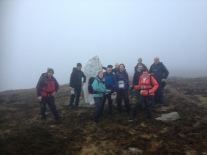 Group pictured at white standing stone under Seefin