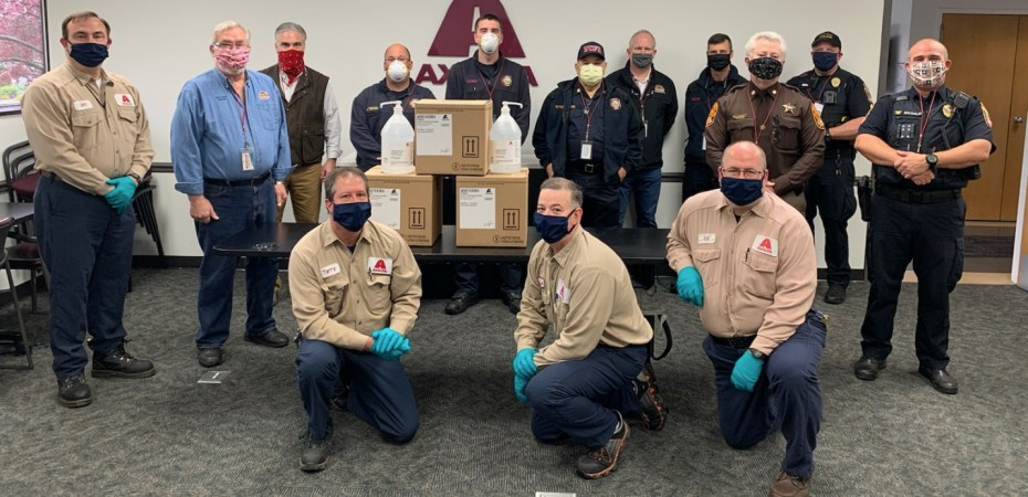 Axalta's Plant Manager Jim Belson, Area Manager Terry Borden, Chemist Chris Utter and Warehouse Manager Ed Henry are joined by Front Royal and Warren County Officials to recognize the donation of over 600 gallons of hand sanitizer. Courtesy photo.