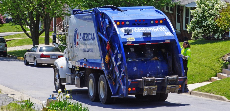 A truck from American Disposal Services collects recyclable items on a Strasburg, Va. street Wednesday, May 13, 2020.