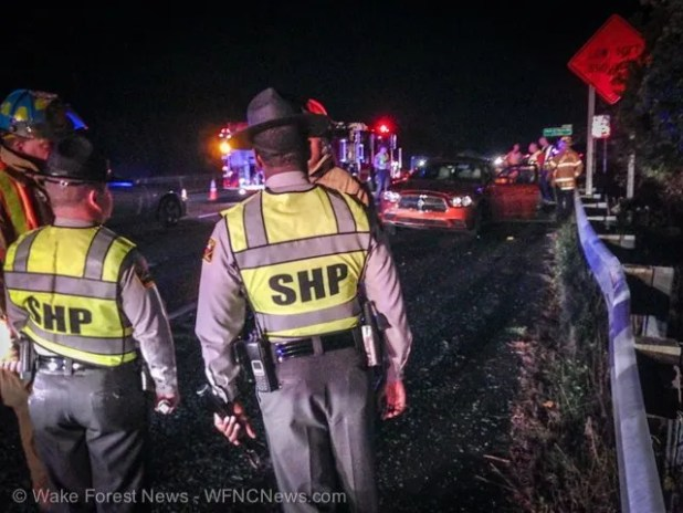 State troopers examine the scene of the accident.