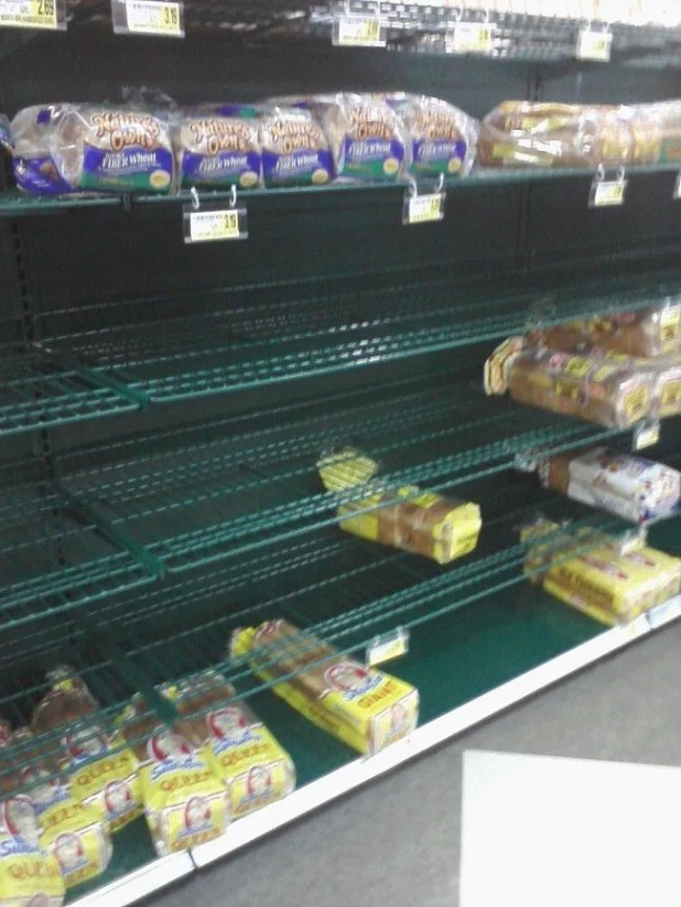 Alan sent in this picture of the bread rack at Harris Rd/Capital Blvd Harris Teeter, 11:30AM Wednesday. Wake Forest residents never disappoint in clearing out the bread for a storm.