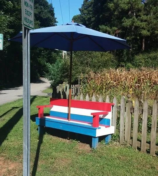 "Chelsey sent this in as a followup to an article where I had a picture of the bench with just a stripper pole. She said, ""The pole is for an umbrella. Perhaps they read your article and put it out for clarification?"" Nice. But they need to put the shade out from the umbrella."