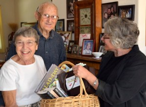 Maj and Hap Hapworth receive the Winters Literay Trasure basket donor prize from Lisa Nalbone.