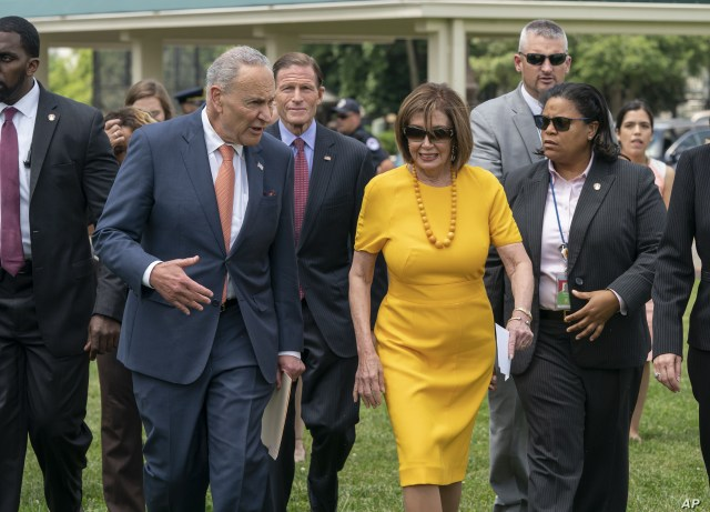 FILE - Senate Minority Leader Chuck Schumer, D-N.Y., left, and Speaker of the House Nancy Pelosi, D-Calif., walk together at the Capitol in Washington, June 20, 2019.