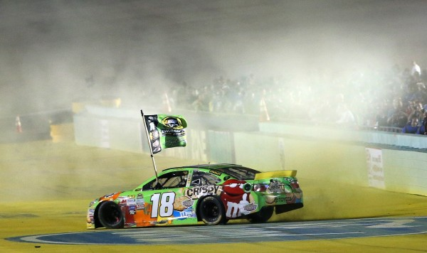 HOMESTEAD, FL - NOVEMBER 22:  Kyle Busch, driver of the #18 M&M's Crispy Toyota, celebrates with a burnout after winning the series championship and the NASCAR Sprint Cup Series Ford EcoBoost 400 at Homestead-Miami Speedway on November 22, 2015 in Homestead, Florida.  (Photo by Mike Ehrmann/Getty Images)
