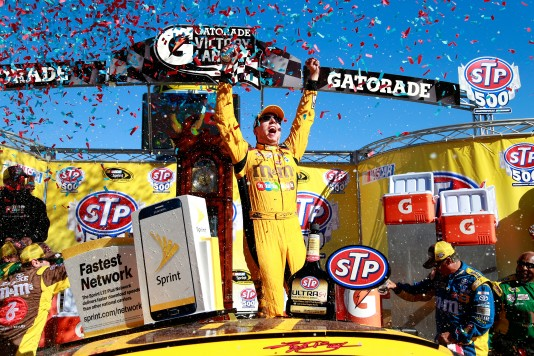 MARTINSVILLE, VA - APRIL 03:  Kyle Busch, driver of the #18 M&M's 75th Anniversary Toyota, celebrates in Victory Lane after winning the NASCAR Sprint Cup Series STP 500 at Martinsville Speedway on April 3, 2016 in Martinsville, Virginia.  (Photo by Matt Sullivan/NASCAR via Getty Images)