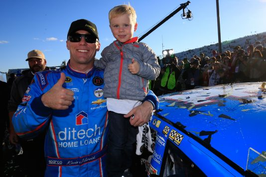 LOUDON, NH - SEPTEMBER 25:  Kevin Harvick, driver of the #4 ditech Chevrolet, and his son, Keelan, pose with the winners' decal in Victory Lane after winning the NASCAR Sprint Cup Series Bad Boy Off Road 300 at New Hampshire Motor Speedway on September 25, 2016 in Loudon, New Hampshire.  (Photo by Chris Trotman/NASCAR via Getty Images)