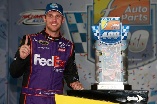 RICHMOND, VA - SEPTEMBER 10:  Denny Hamlin, driver of the #11 FedEx Ground Toyota, poses with the trophy in Victory Lane after winning the NASCAR Sprint Cup Series Federated Auto Parts 400 at Richmond International Raceway on September 10, 2016 in Richmond, Virginia.  (Photo by Matt Sullivan/NASCAR via Getty Images)