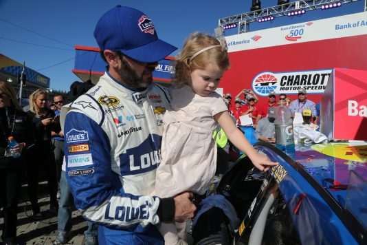 CHARLOTTE, NC - OCTOBER 09:  Jimmie Johnson, driver of the #48 Lowe's Chevrolet, celebrates in victory lane after winning the NASCAR Sprint Cup Series Bank of America 500 at Charlotte Motor Speedway on October 9, 2016 in Charlotte, North Carolina.  (Photo by Jerry Markland/NASCAR via Getty Images)