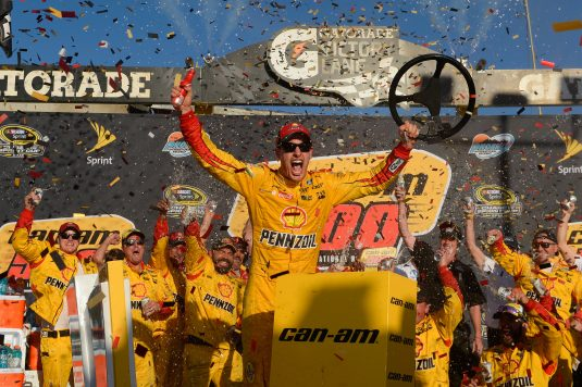 AVONDALE, AZ - NOVEMBER 13:  Joey Logano, driver of the #22 Shell Pennzoil Ford, celebrates in Victory Lane after winning the NASCAR Sprint Cup Series Can-Am 500 at Phoenix International Raceway on November 13, 2016 in Avondale, Arizona.  (Photo by Robert Laberge/NASCAR via Getty Images)