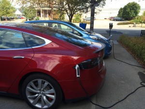 A Tesla and Leaf charging at the Green Building's new charger.