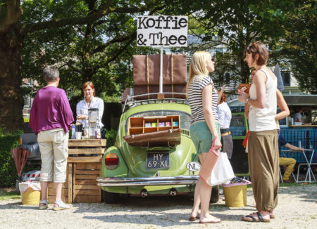 Dordrecht, Netherlands - July 27, 2014: Selling coffee and tea out of a car at the summer Swan Market in Dordrecht. The lifestyle market was originally started in vacant shops in Rotterdam