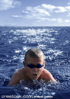 !0-11 year boy swimming