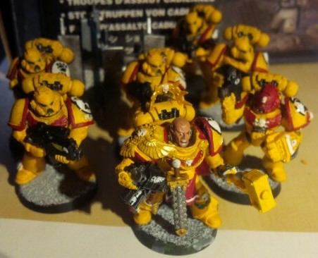 Space Marine Captain leading a small tactical squad of Imperial Fists Marines