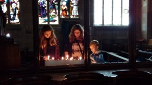 My daughter and friends light candles for their loved ones.