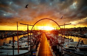 Beautiful sunset at the docks of the harbor in Blanes.