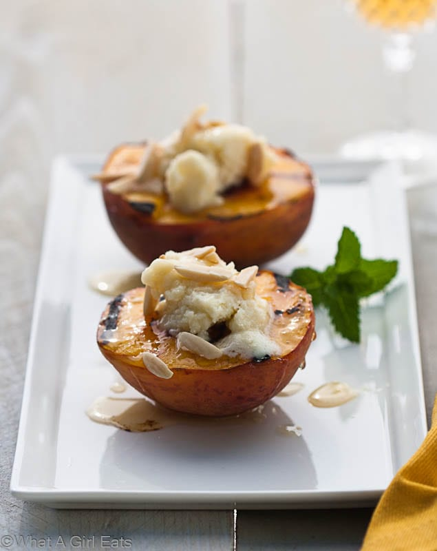 Grilled peaches, filled with slightly sweetened Mascarpone cheese, drizzled with a bit of honey, topped almonds