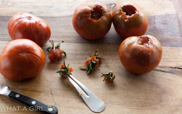 Core and cut a cross in the bottom of each tomato.