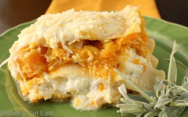 Butternut Squash Lasagna is tender lasagna noodles, cooked in a savory, creamy butternut squash sauce with sage and Italian cheeses. | Recipe from @whatagirleats | WhatAGirlEats.com
