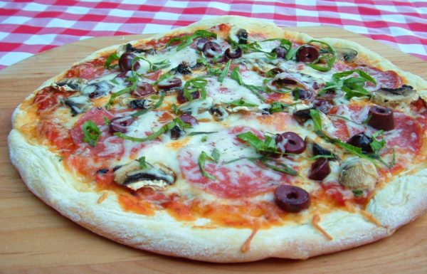 Homemade pizza, made with Artisan olive oil bread dough. Recipe on WhatAGirlEats.com