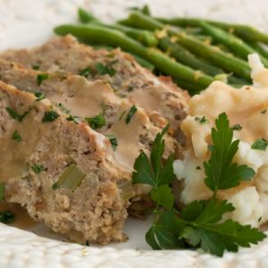 Turkey Meatloaf, mashed potatoes and lemony green beans This is a really good meatloaf recipe, with a secret ingredient to keep it moist! | WhatAGirlEats.com