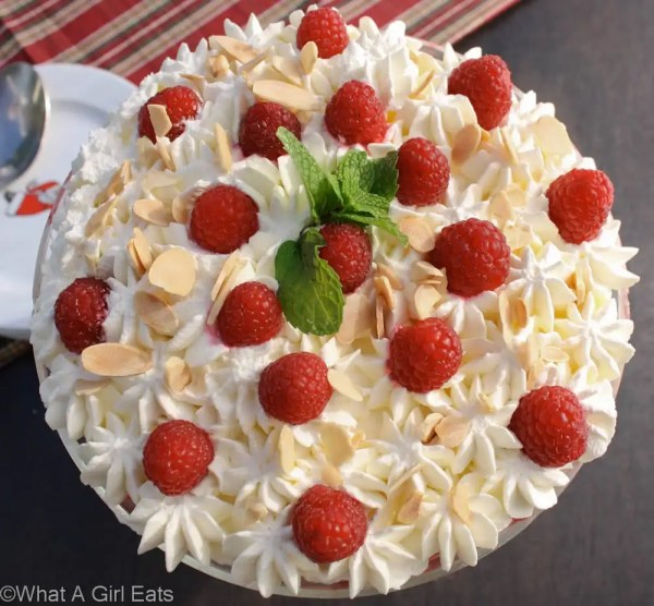 Trifle is a classic English dessert, with layers of pound cake, custard, fresh fruit, and whipped cream. This holiday trifle uses raspberries and poached pears, making it as delicious as it is beautiful. | What a Girl Eats