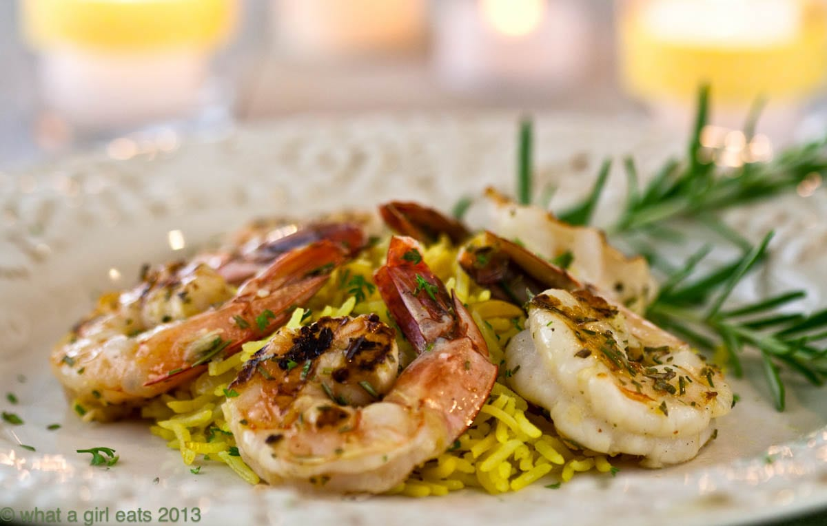 Grilled rosemary shrimp rice pilaf is an easy dinner recipe to make. Large shrimp, marinated with fresh rosemary and grilled, served with tender rice pilaf. | @whatagirleats