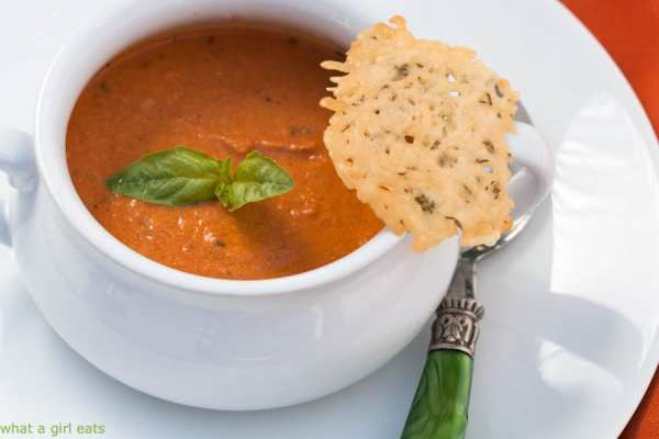 Tomato basil soup with goat cheese requires just a few simple ingredients to make. This easy soup recipe is perfect comfort food. | WhatAGirlEats.com