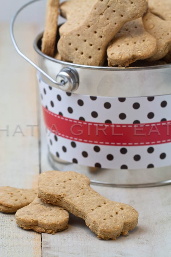 Show your furry friend how loved they are by making them Homemade Dog Treats! Recipe on WhatAGirlEats.com