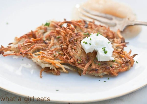Crispy potato latkes are a delicious side dish, often served at Jewish meals around the holidays. Seasoned potato pancakes that are tender on the inside and crispy on the outside.