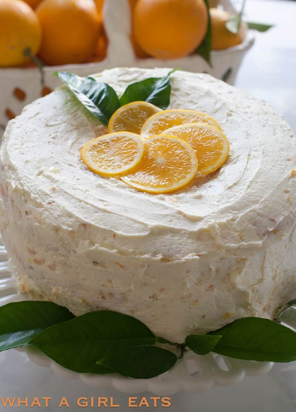 Orange cream angel food cake is a light, flavorful cake and perfect for a spring or summer dessert. With its refreshing citrus and vanilla flavors, this cake is reminiscent of a Creamsicle!   @whatagirleats