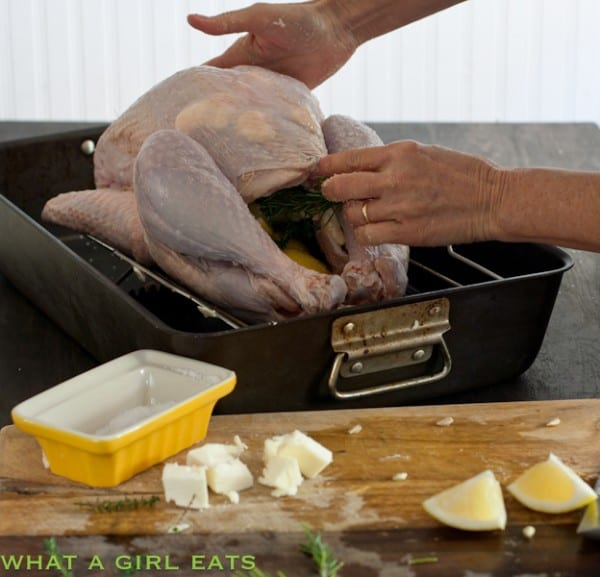 Slid some butter and salt under the skin. Stuff some lemon wedges and herbs in the cavity of the bird.