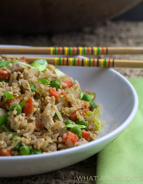 Pork fried rice is a flavorful Asian dish, packed with tender rice, bite sized pieces of pork, and crisp vegetables. Making it at home is incredibly quick and easy to do! | What a Girl Eats