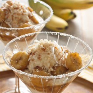 Bananas Tropical. Bananas, caramelized with butter, brown sugar and rum served over vanilla ice cream with toasted coconut and macadamia nuts.