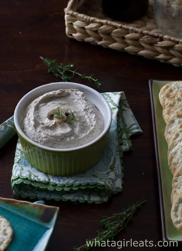 Mushroom spread is a creamy holiday dip recipe, made with earthy mushrooms, cream cheese, and spices. Don't let the gray color keep you from the great taste! | Recipe on WhatAGirlEats.com