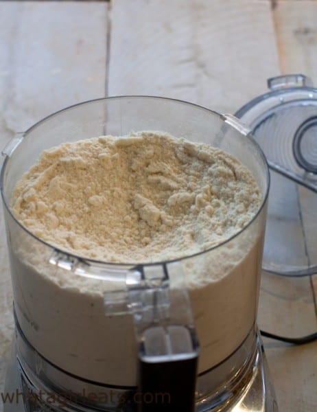 Mix dry ingredients and butter in a food processor.