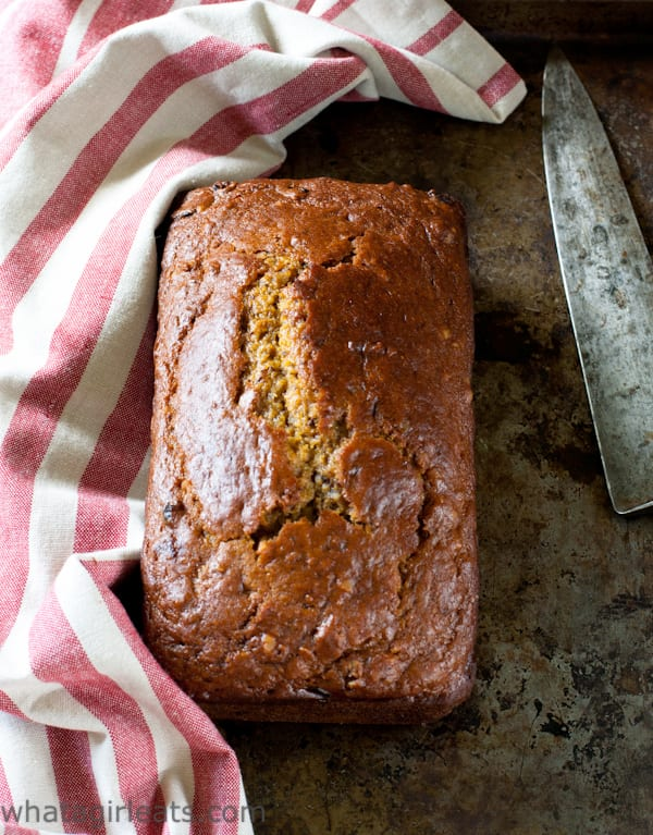 Moist and tender Pumpkin Cranberry Bread with Walnuts and a hint of autumn spices.   Recipe on WhatAGirlEats.com