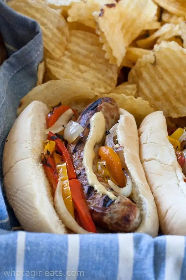 Bratwurst subs with spicy pub mustard and grilled onions and peppers.