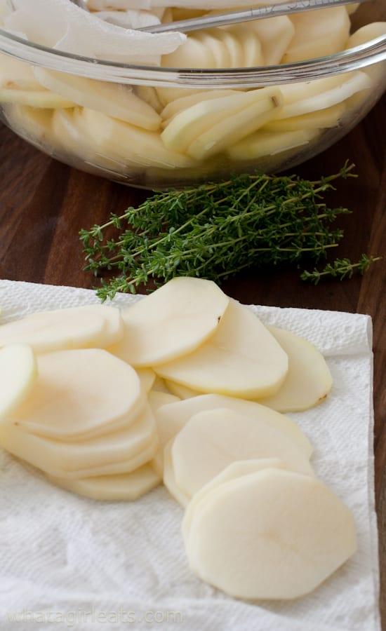 sliced potatoes on paper towel