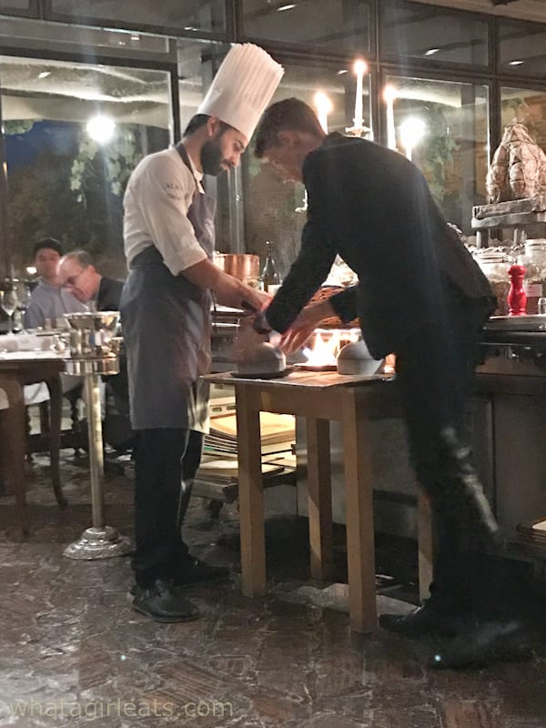 Chef and waiter serving