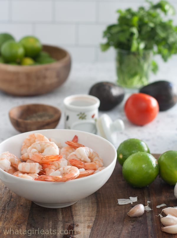 Ingredients for ceviche; shrimp and lime.