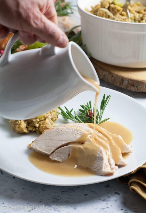 pouring gravy on turkey