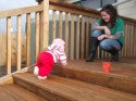 Child crawling up stairs