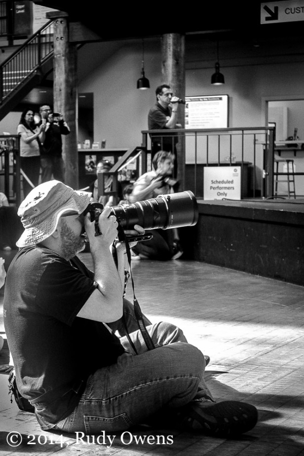 Every performance I attend these days has someone with some photographic device capturing the moment and definitely disrupting the view and listening experience. Or, has it always been that way and I need to chill out? Taken at the Seattle Center on June 28, 2014.)