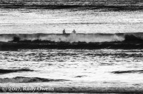 A pair of surfers waits for the right waves at Seaside Cove on May 12, 2017.