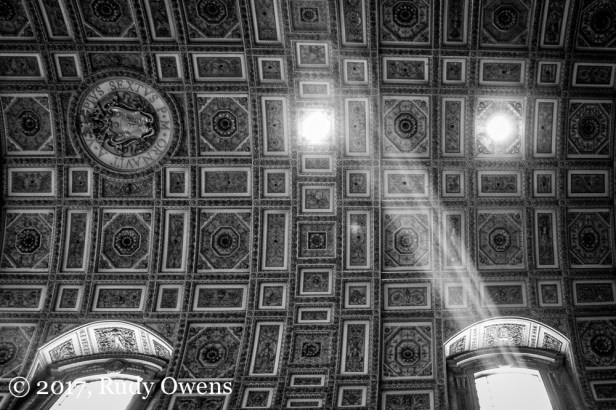 "A so-called ""god beam"" illuminates the vaulted ceiling of St. Peter's Basilica, in the Vatican City, in Rome."