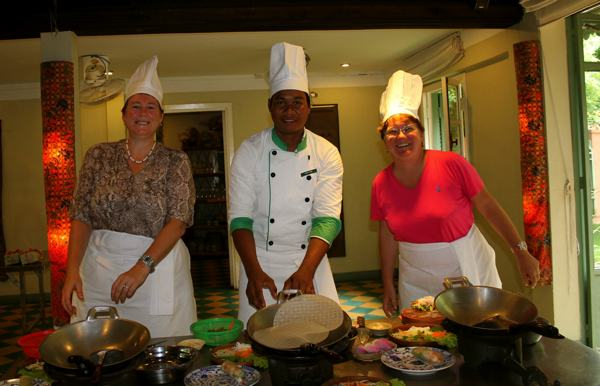 Cheryl and Lisa learning from the Chef at The Champey Cooking Class